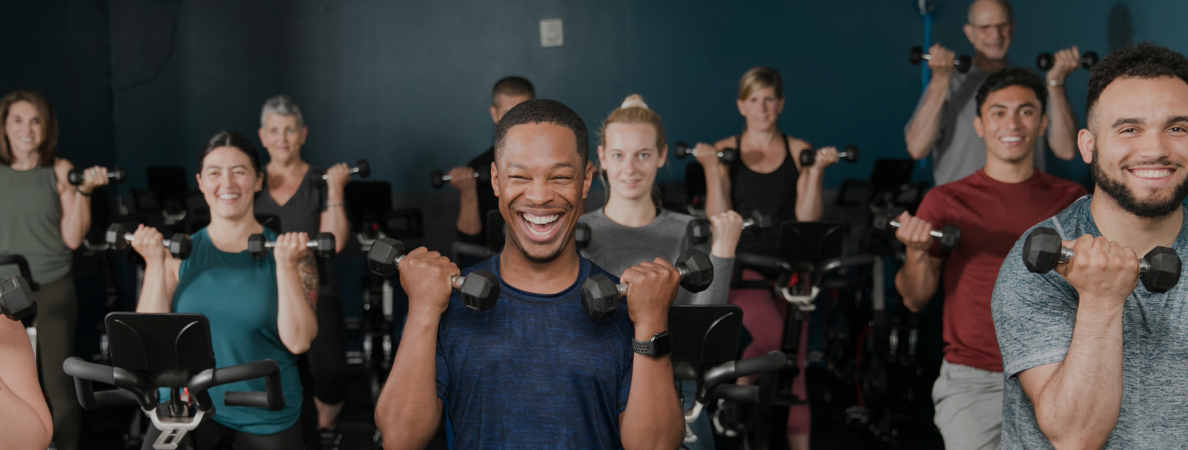 group fitness class using dumbbells
