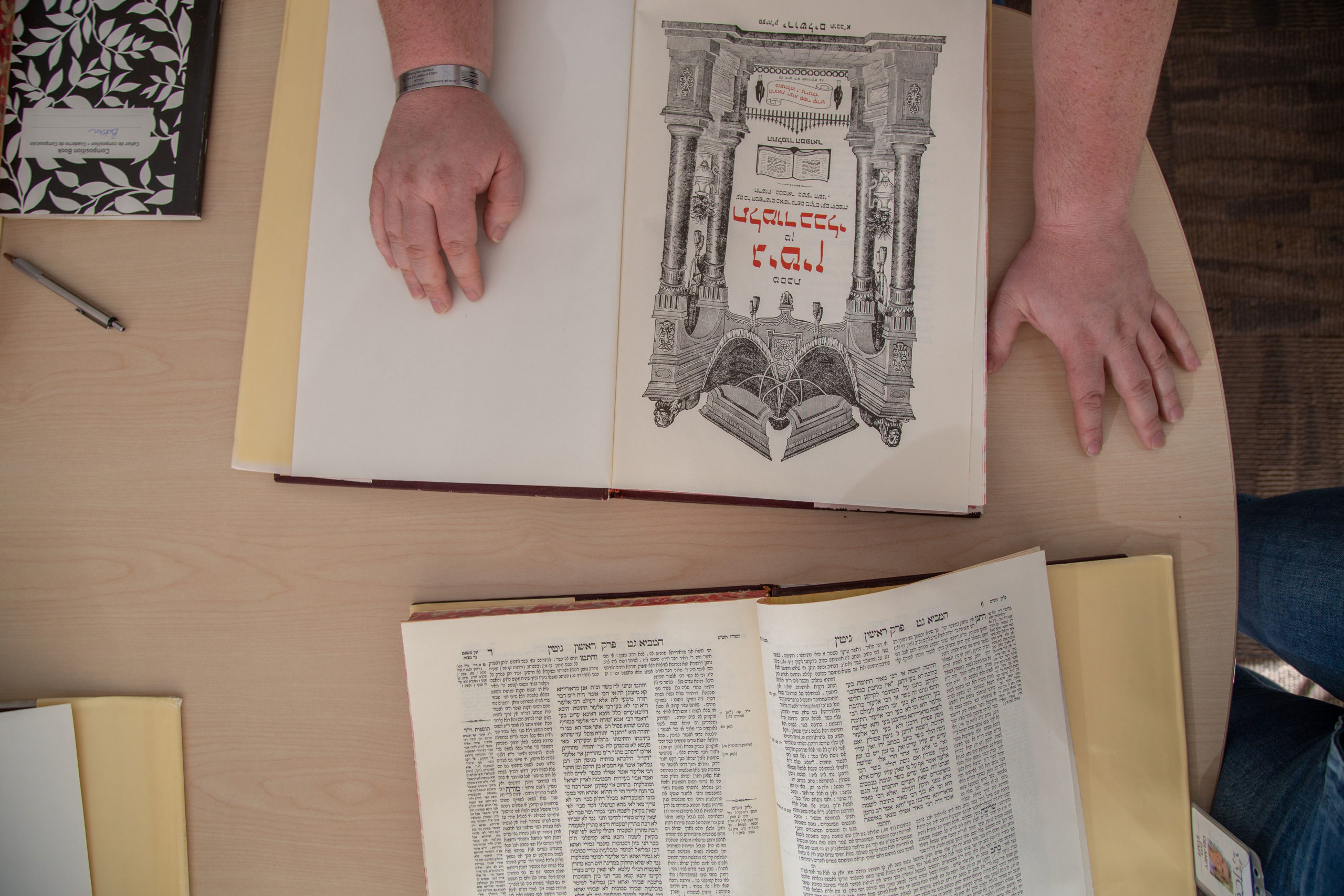Photo of book with hands resting on it
