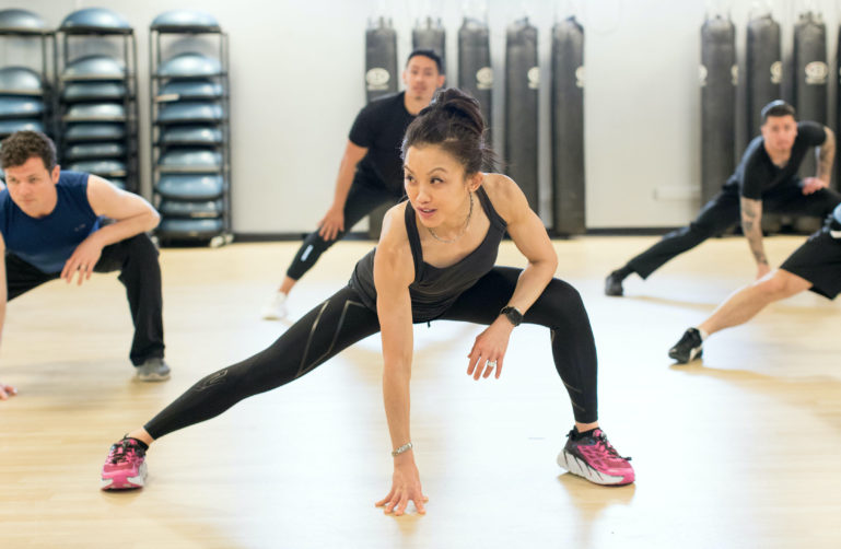 Woman Attends Cardio Fitness Class
