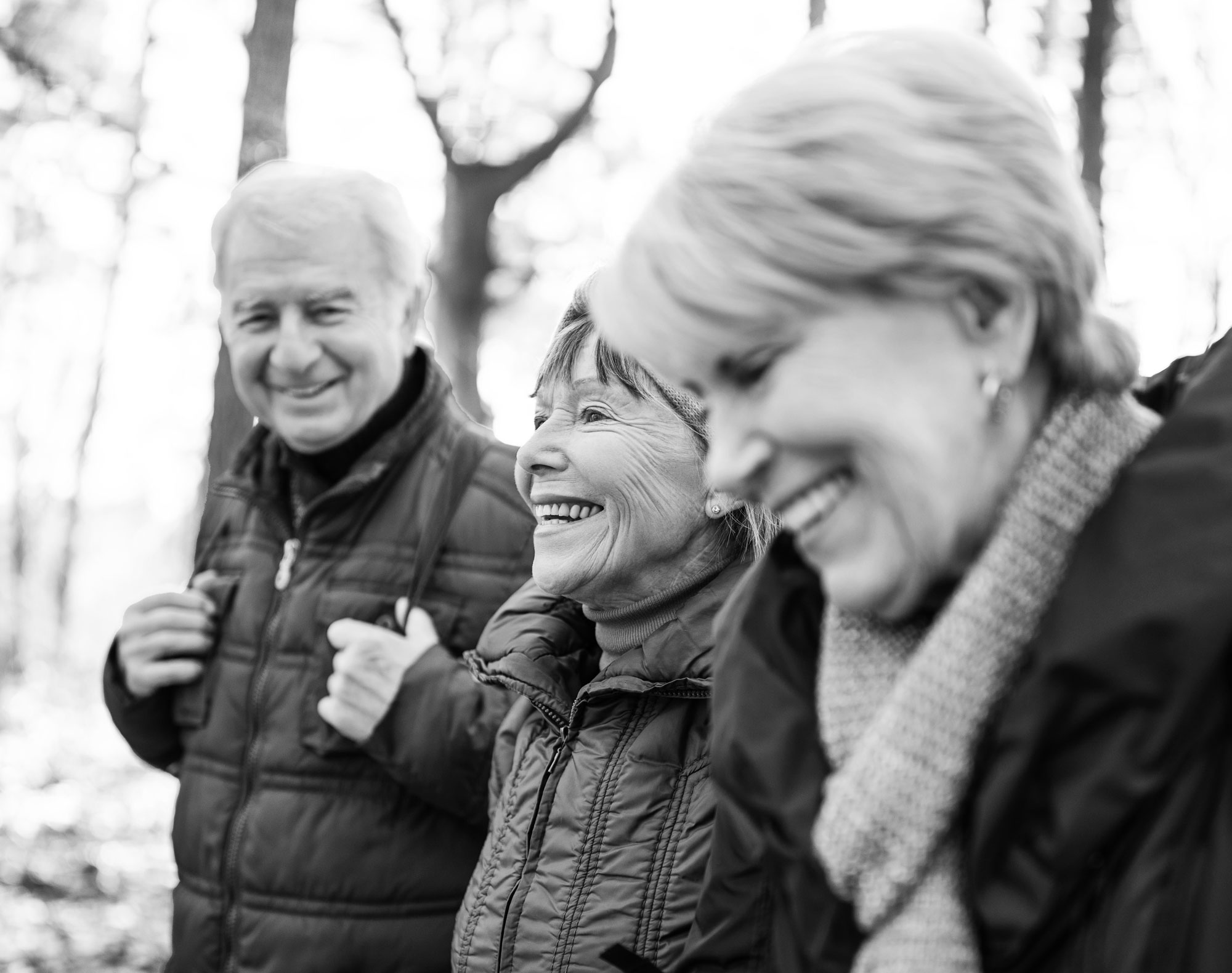 three senior citizens laughing together