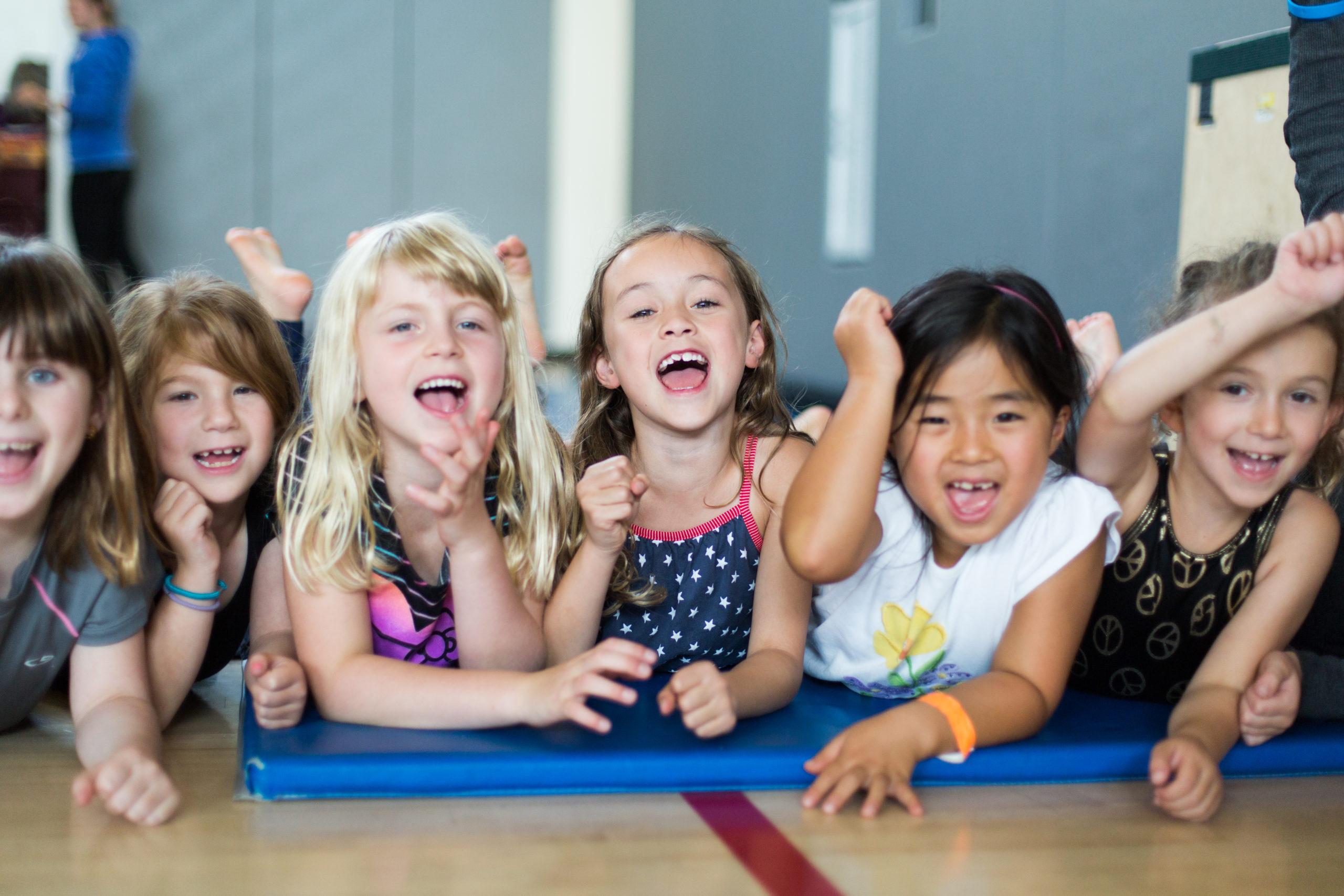 kids at winter camp smiling together