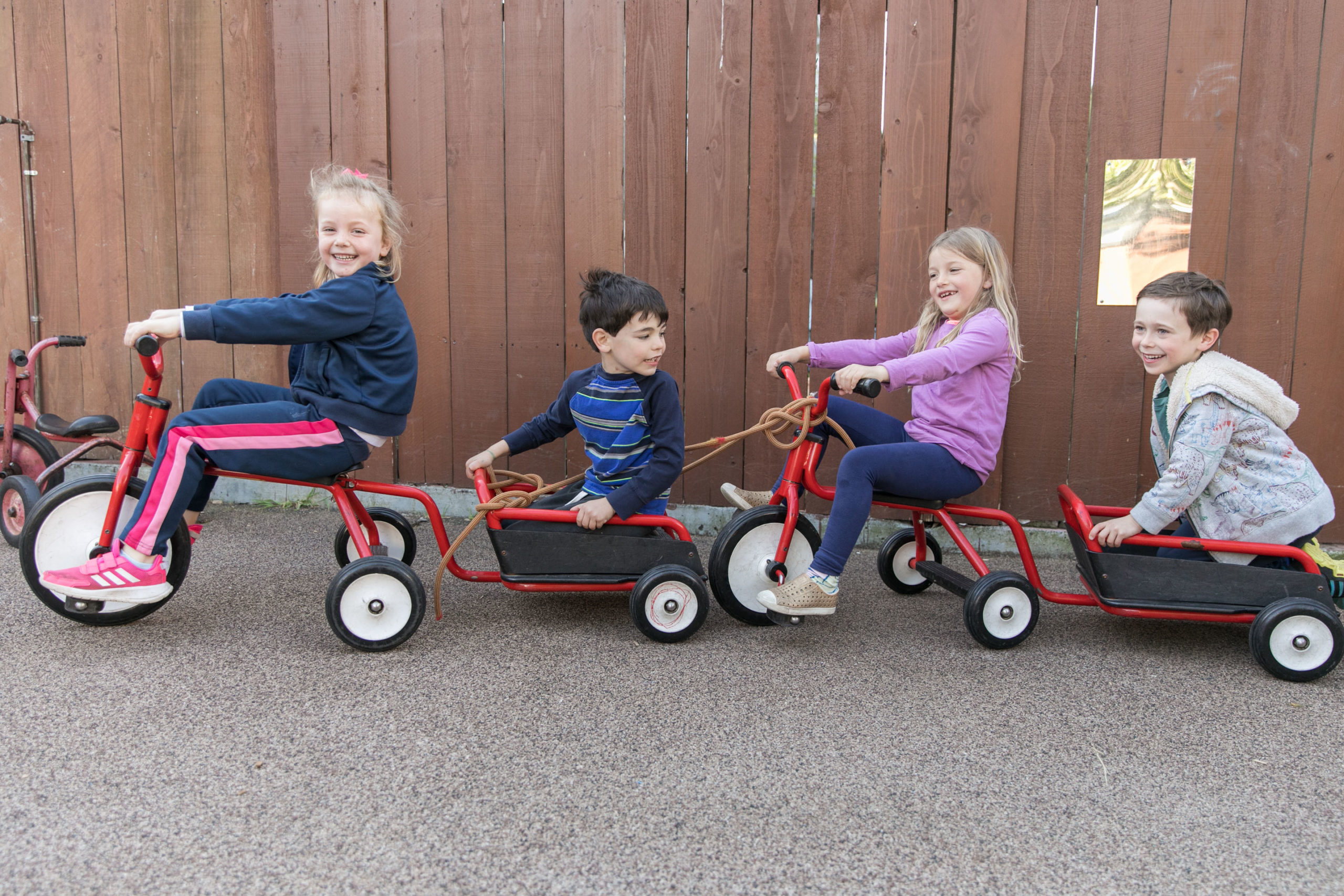 Children riding a bicycle train