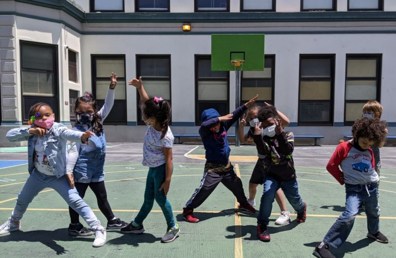 Kids dancing on the playground
