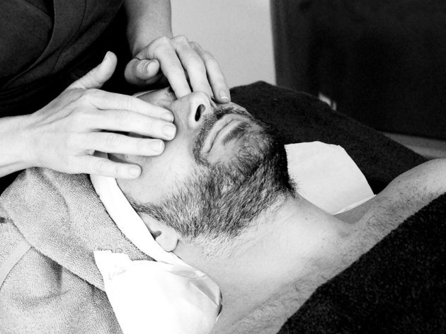 Man getting facial massage
