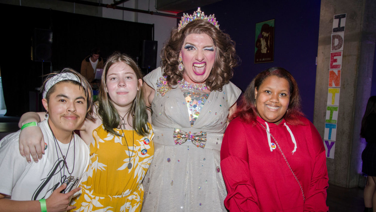 Group of teens pose with drag queen