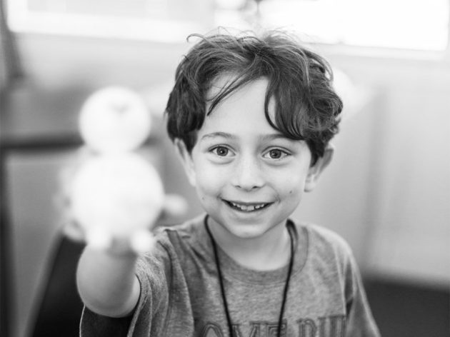 black and white photo of boy smiling
