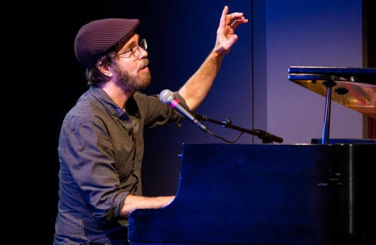 Ben Folds performs on piano