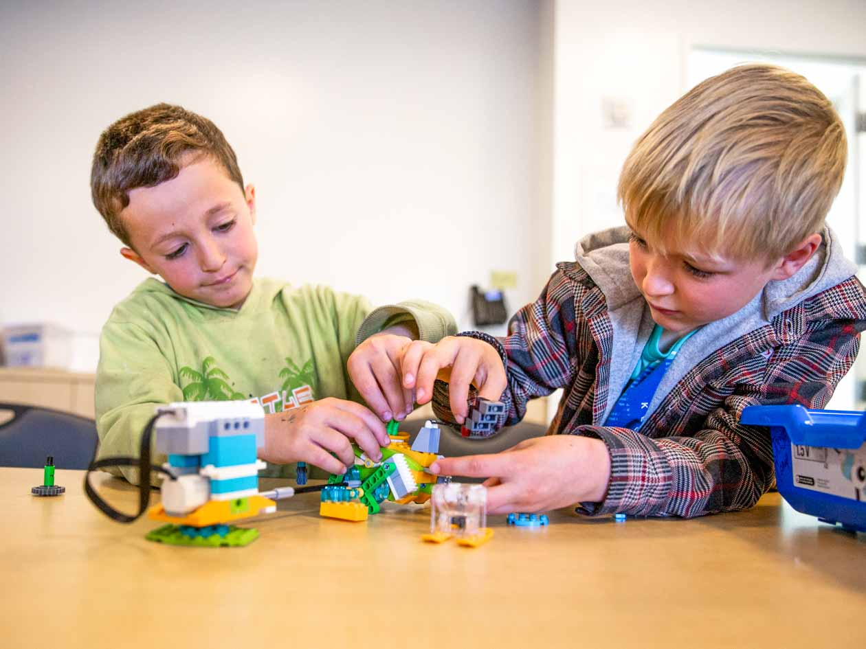 Young boys build with Legos