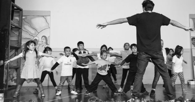 Children learning to dance from adult