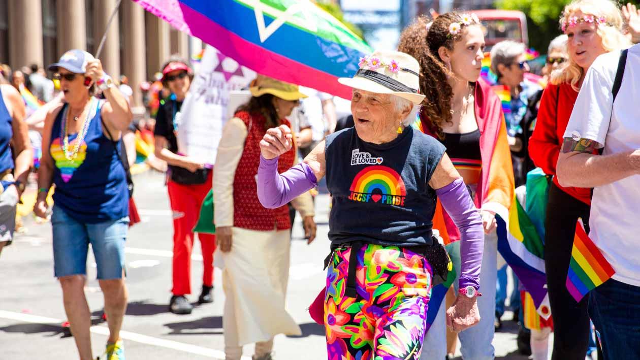 Elderly woman walks in Pride parade