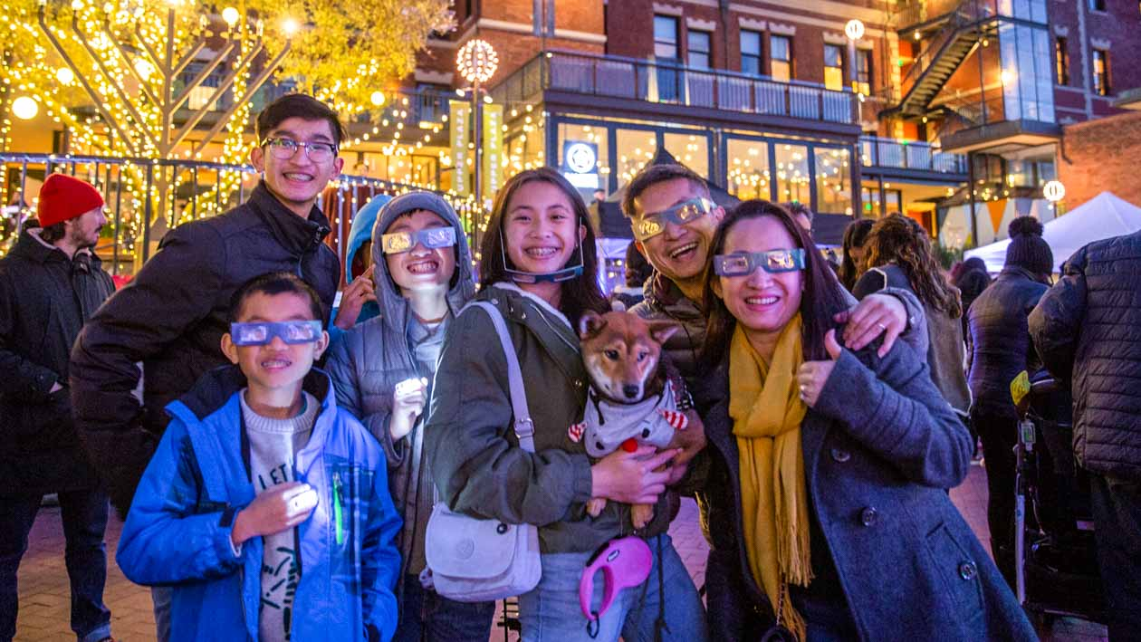 Group poses for photo at Ghirardelli popup