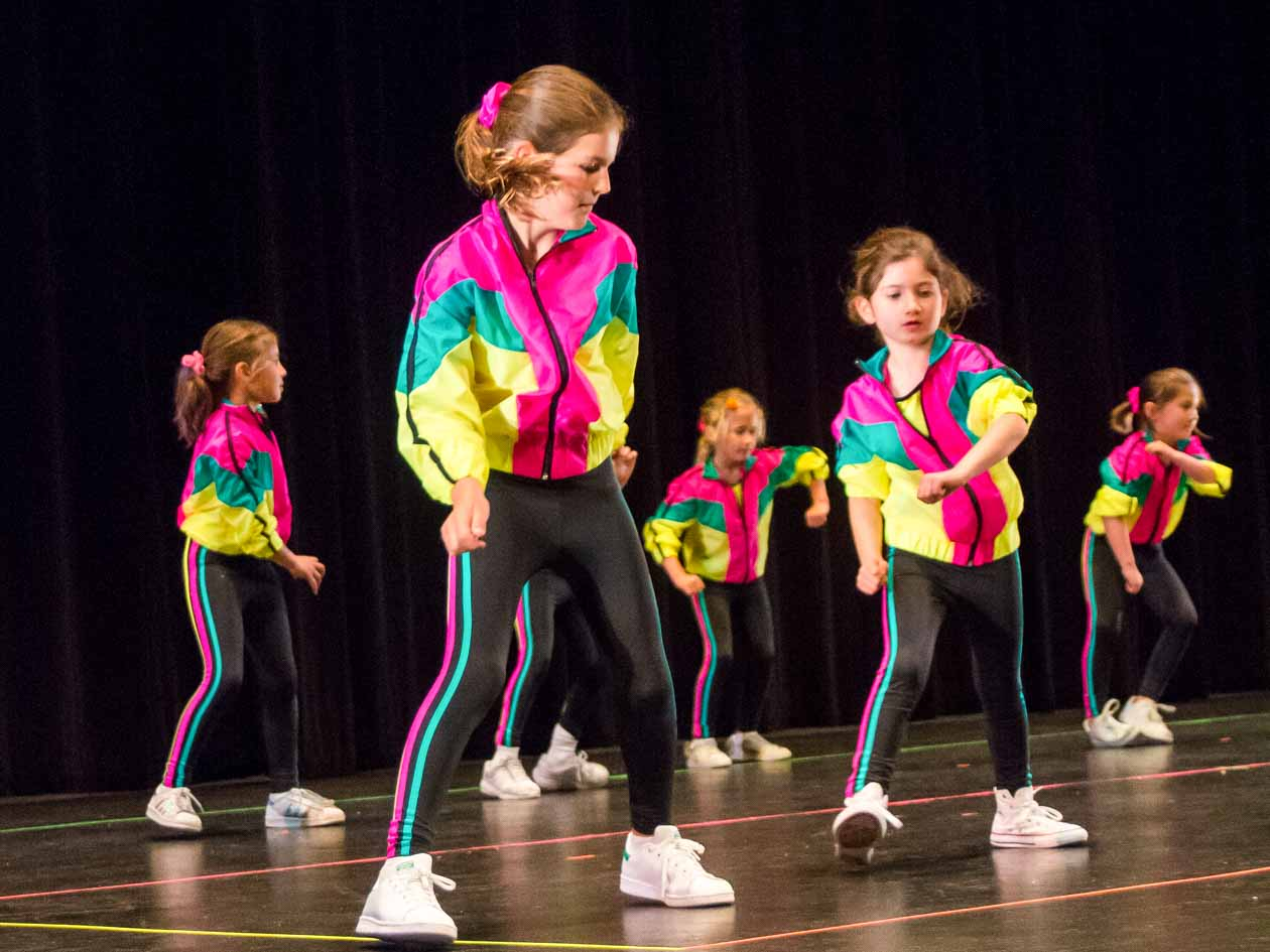 Young girls perform hip-hop dance