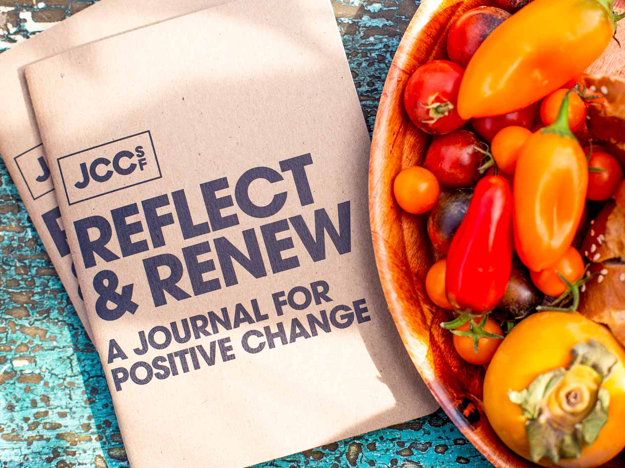 JCCSF pamphlet sits beside bowl of vegetables