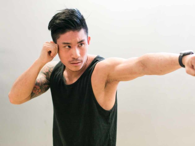 Man in punching form during JCCSF fitness class