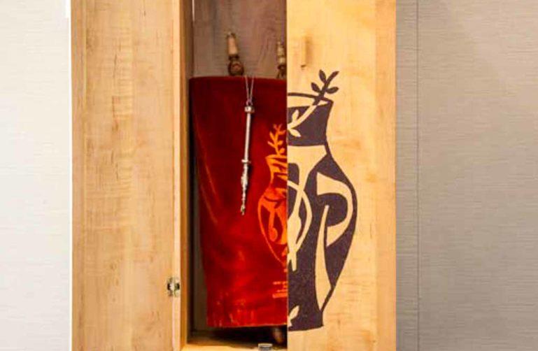 Closet door open to reveal red cloth