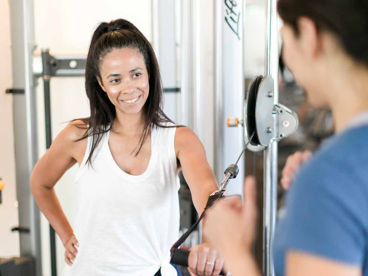 JCCSF member talks with personal trainer
