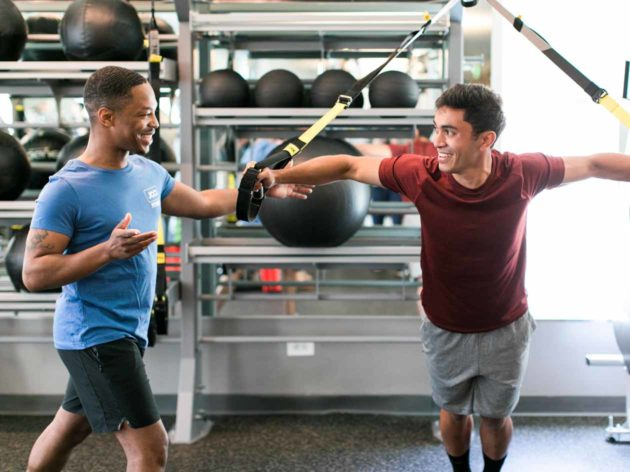 Personal trainer helps with resistance training