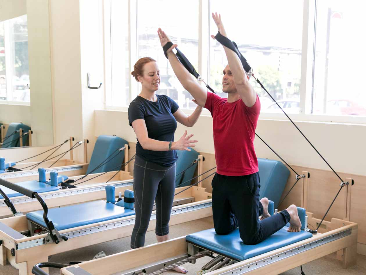 Private pilates training with resistance bands