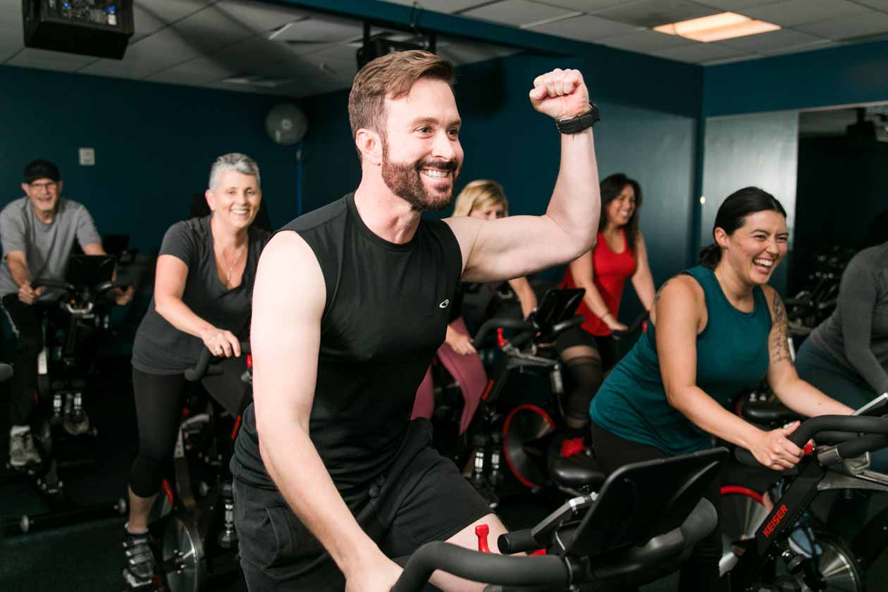 Man fist pumps during spin class