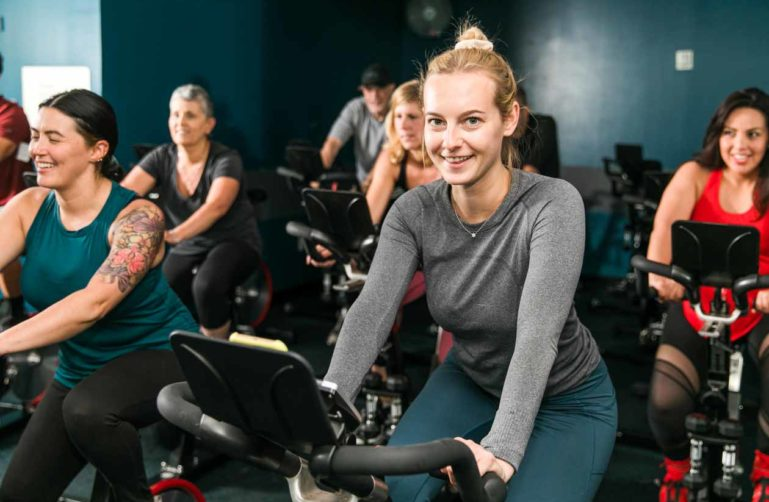 Smiling woman in spin class