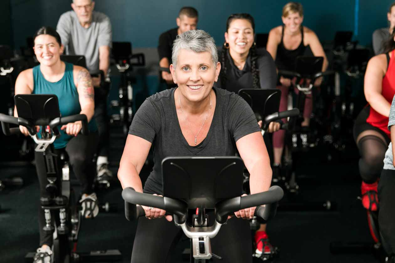 Smiling spin class attendees