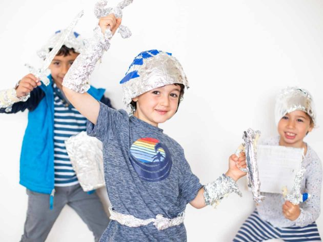 Children dressed in crafted tinfoil costumes