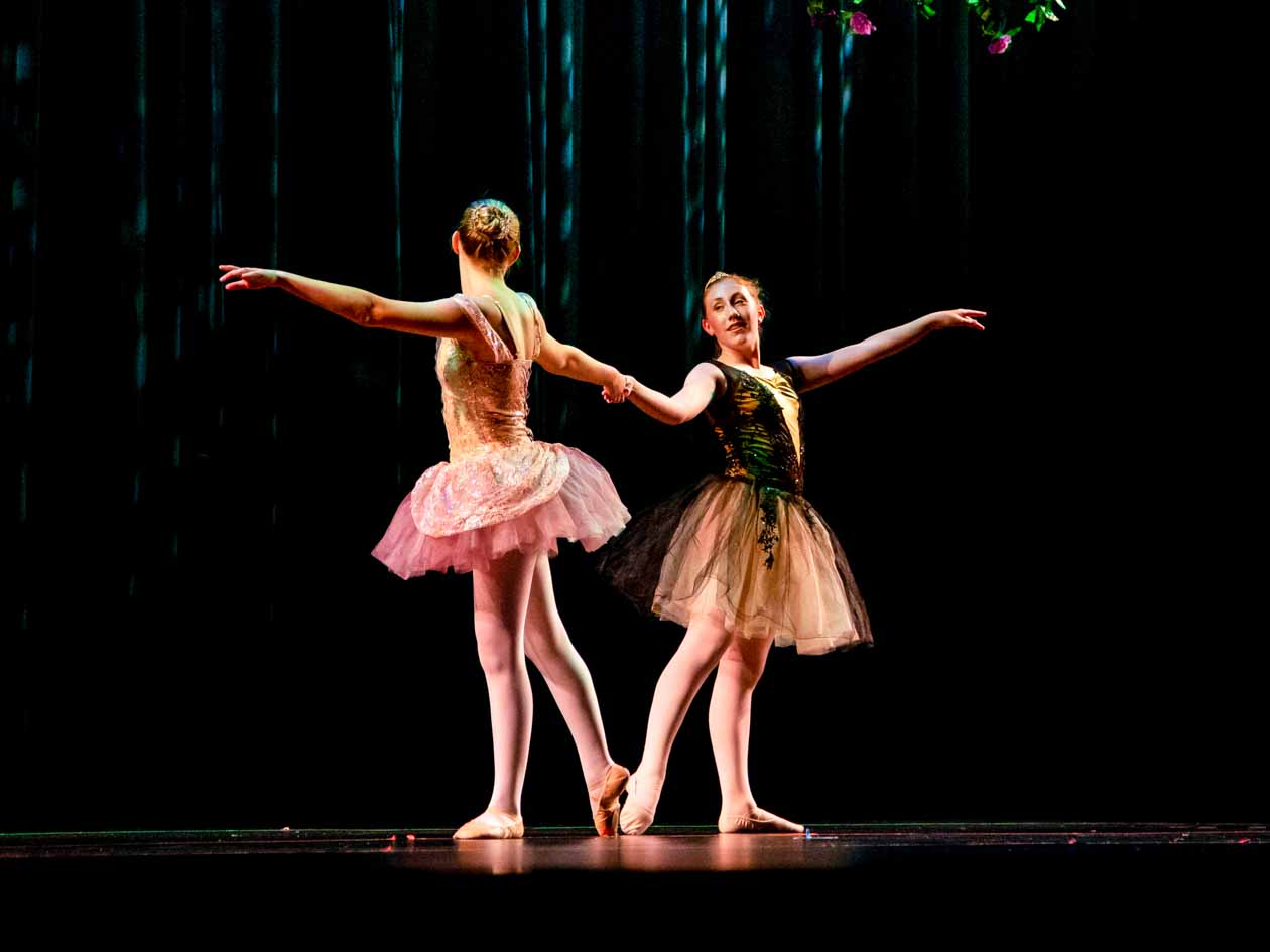 Two girls perform ballet together on stage