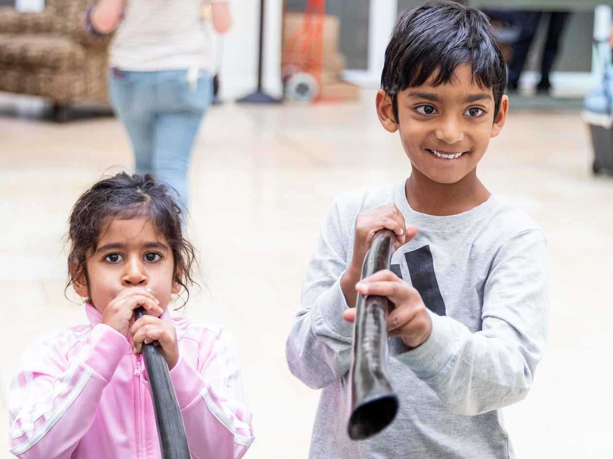 Young children play wooden flutes at JCCSF gathering