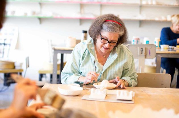 Woman participates in adult ceramics class
