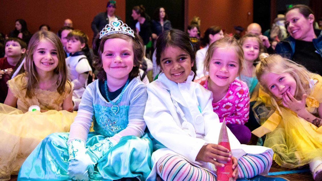 Smiling children in costume to celebrate Purim