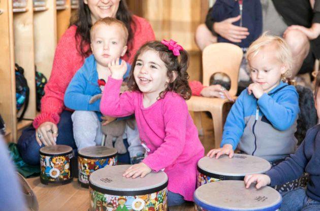Preschool class uses children's drums