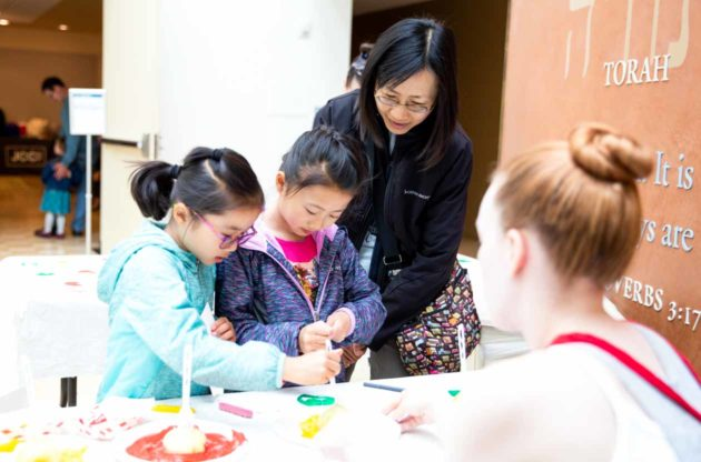 Young girls try potato stamps at Family Festival