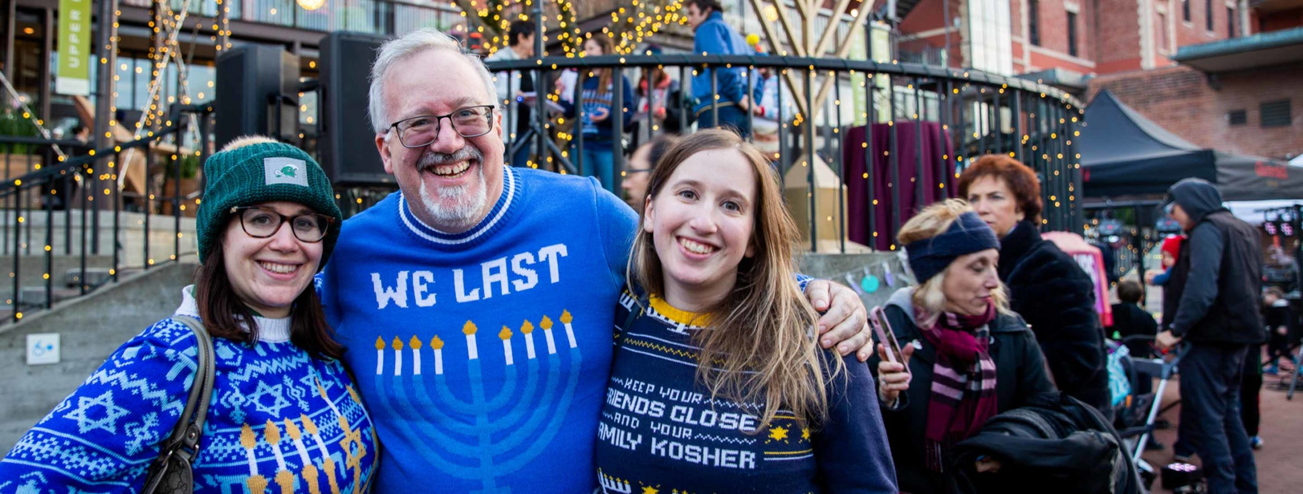 Three people pose for Hanukkah group photo