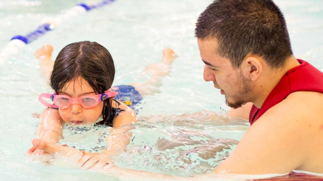 JCCSF swim instructor teaches young girl