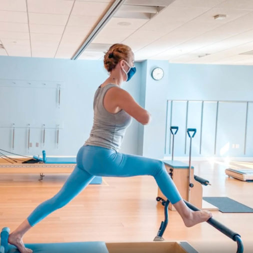 Woman doing pilates in the gym