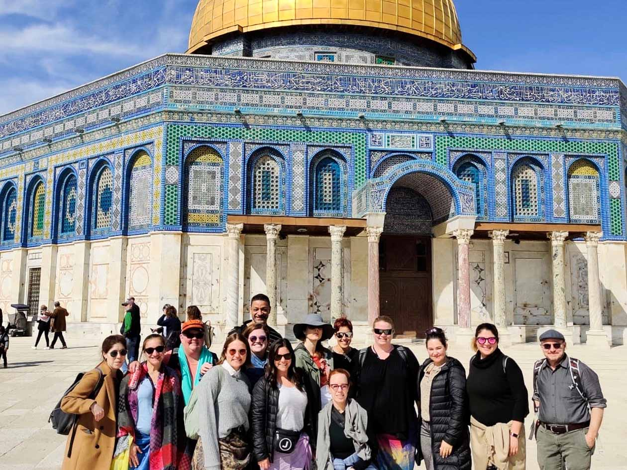Staff Israel Seminar group poses in front of Jewish temple