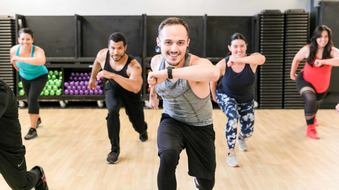 Zumba class lunges during dance