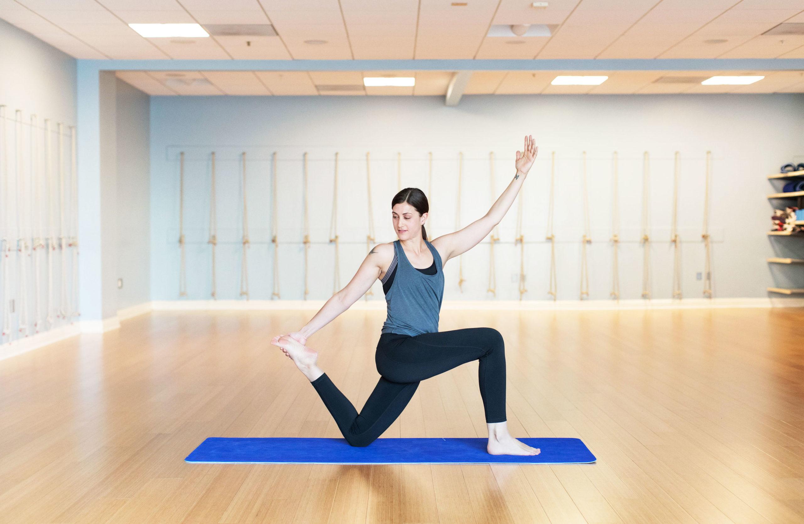 woman stretching on yoga mat