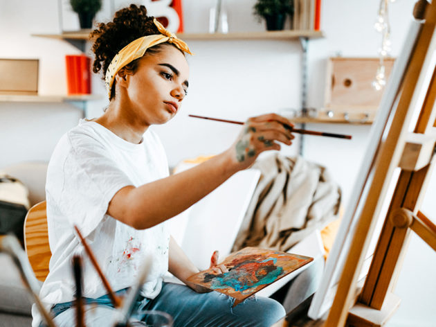 young female artist in her apartment
