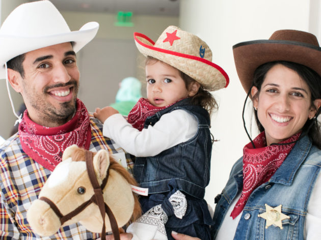 Family dressed in costume as cowboys