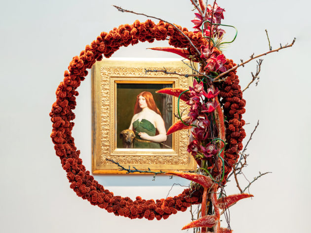 red round bouquet around a gold framed picture