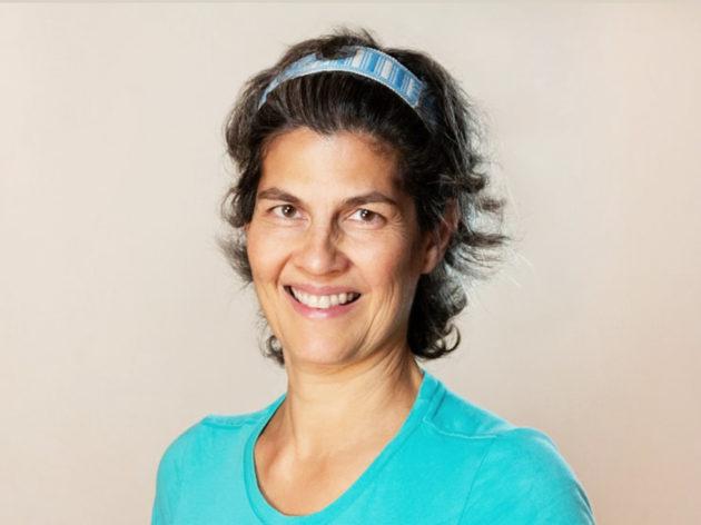 A headshot of Esther Gokhale smiling