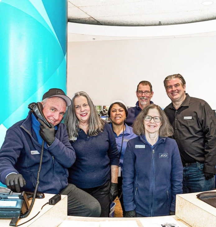 picture of 6 front desk staff in JCCSF shirts and jackets